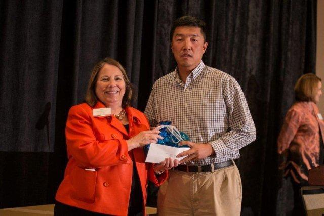 TechConnectWV Board Member Taunja Willis-Miller and 2013 Innovator of the Year Dr. Xingbo Liu Dr. Xingbo Liu