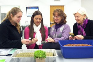 WJU students join faculty member Dr. Mary Railing and Dr. Laurie Ruberg, founder of the new Wheeling-based tech company, PLANTS, LLC in examining hydroponics systems.