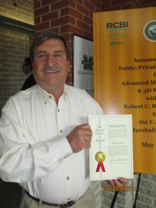 Tim Bell, owner of Craft-Totes by Bell, with the patent certificate the company received from the U.S. Patent Office