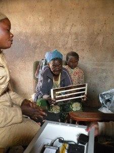 A happy recipient of a solar light in Kenya