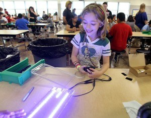 """A student volunteer helps create lights for the """"Light Haiti"""" project"""