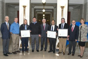 Award winners: L-R: Carl Irwin, TransTech Energy Program; Dennis Ruth, Jeff Arbogast, and Mike Bombard of Armstrong World Industries; WV Cabinet Secretary Keith Burdette; Dr. Gopalakrishnan; John Pauley and Ed Derderian of PolyPlexx; Anne Barth, TechConnectWV